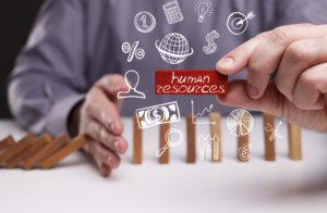 Business, Technology, Internet and network concept. Young businessman shows the word human resources